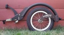 Il ruotino per carrozzine Freewheel e le ruote mountain bike per andare su sabbia, neve e erba con la sedie a rotelle
